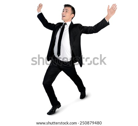 Isolated business man running winner - stock photo