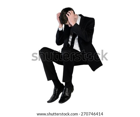 Isolated business man sad looking down - stock photo