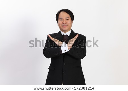 Isolated business man show x symbol on overwhite background - stock photo