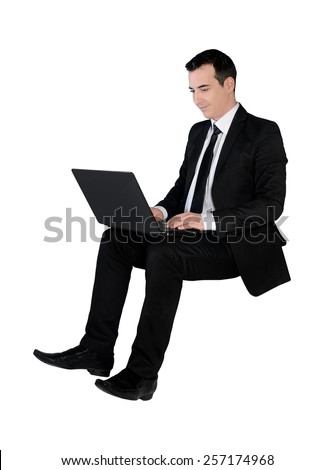 Isolated business man using computer - stock photo