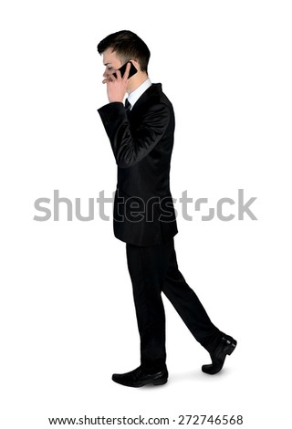 Isolated business man walk with phone - stock photo