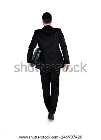 Isolated business man walking back - stock photo