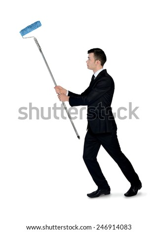 Isolated business man with paint roller