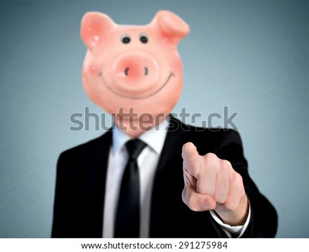 Isolated business man with piggy bank head pointing camera - stock photo