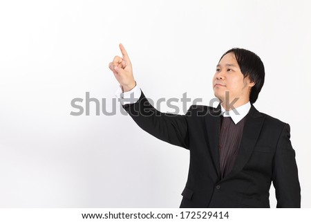 Isolated business man writing whatever you want with him finger - stock photo