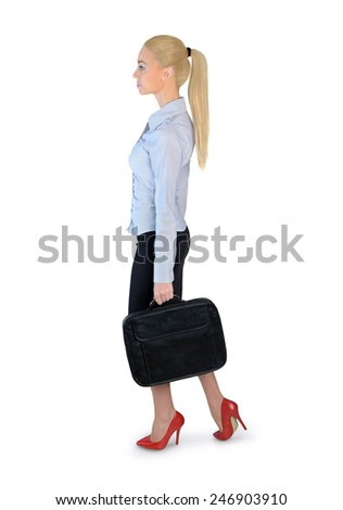 Isolated business woman walking side - stock photo