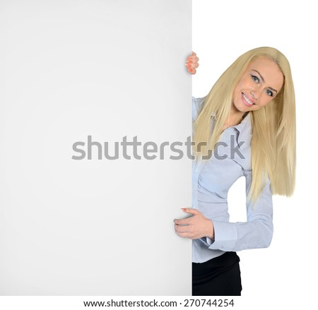 Isolated business woman with empty board - stock photo