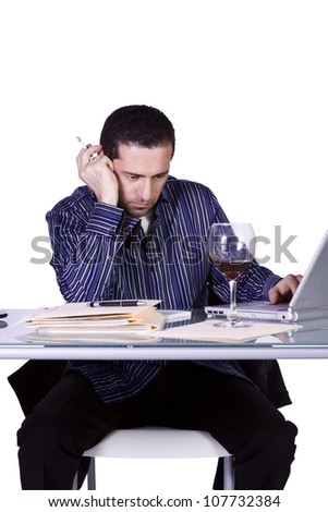 Isolated Businessman At His Desk Working and Drinking Wine- White Background - stock photo