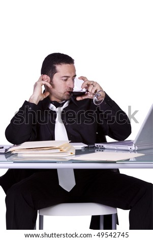 Isolated Businessman At His Desk Working And Drinking Wine - White Background