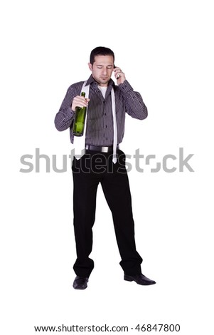 Isolated businessman celebrating with a bottle of drink while talking on the phone