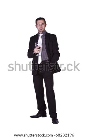 Isolated businessman celebrating with a glass of drink