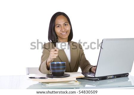 Isolated Businesswoman At Her Desk Holding a Blank Business Card