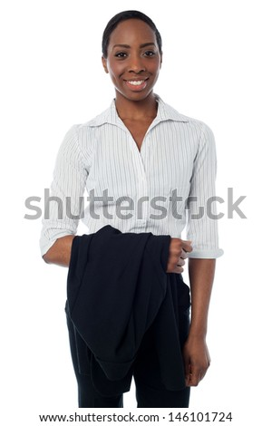 Isolated businesswoman holding coat - stock photo