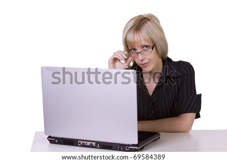 Isolated Businesswoman with spectacles working on laptop