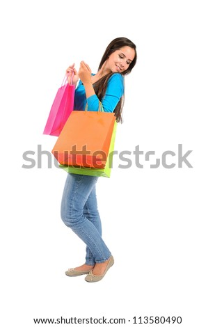 Isolated casual young woman holding shopping bag