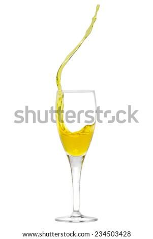 Isolated champagne flute with splashing liquid - stock photo