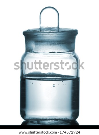 Isolated chemical sample bottle on table with a small reflection, studio shot - stock photo