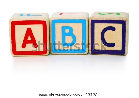 Isolated children's building blocks spelling a b c - stock photo