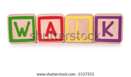 Isolated children's building blocks spelling the word walk