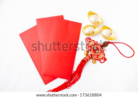 Isolated Chinese red pockets, ancient Chinese golden ingots and Chinese tassel - stock photo