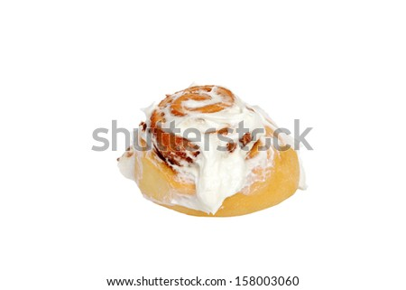 isolated cinnamon bun with icing - stock photo