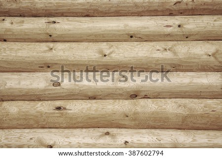 isolated close-up fragment of a new log home in daylight - stock photo