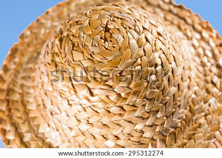 Isolated close up of a sunhat against blue sky