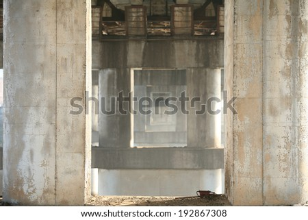 isolated close-up of reinforced concrete bridge across the river - stock photo
