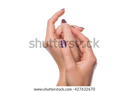Isolated close up on female hands in relaxed gesture with purple fingernail polish over white background