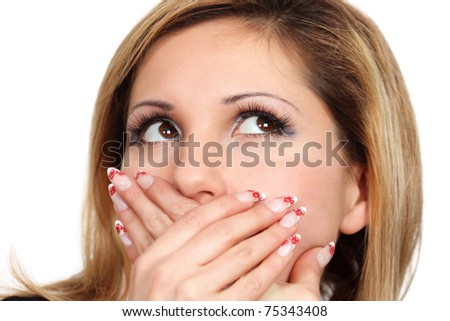 Isolated close up  portrait of young women  with  eyes lifted upwards and  mouth closed by palms, focus on eyes - stock photo
