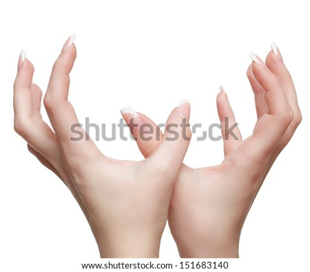isolated close up shot of young woman's healthy hands with french manicure - stock photo