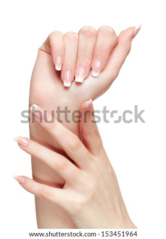 isolated close-up shot of young woman's healthy hands with french manicure - stock photo
