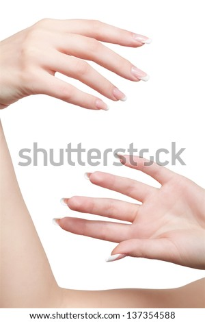 isolated close-up shot of young woman's healthy hands with manicure - stock photo