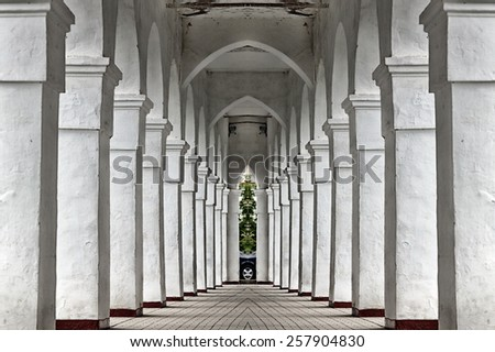 isolated closeup of white columns of an ancient building - stock photo
