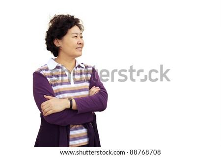 Isolated closeup portrait photo of Chinese senior housewife - stock photo