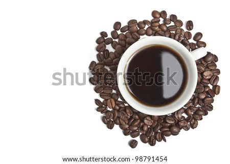 Isolated coffee cup with coffee beans - stock photo