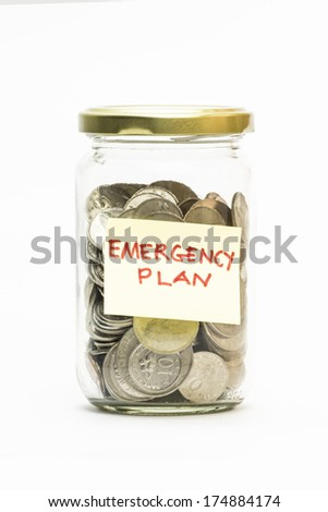 Isolated coins in jar with emergency plan label - financial or business concept