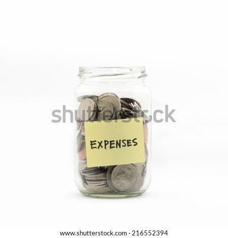 Isolated coins in jar with expenses label - financial concept - stock photo
