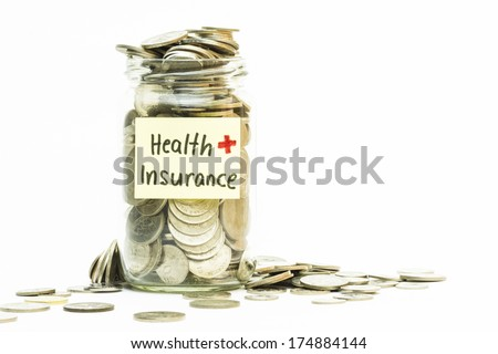 Isolated coins in jar with health insurance label - financial concept - stock photo