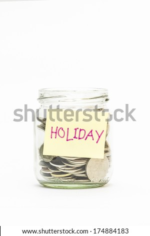 Isolated coins in jar with holiday label - financial concept