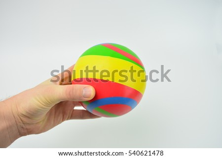 Isolated color ball on white background. Play ball games. Ball in hand