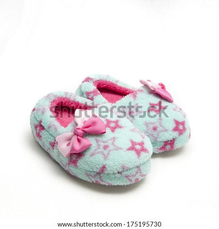 isolated composition of two child slippers