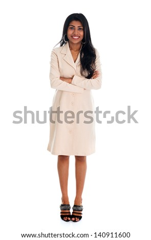 Isolated confident Indian businesswoman smiling at the camera, full body standing against white background. - stock photo