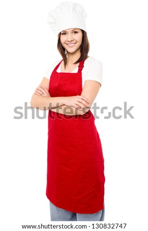 Isolated  confident young baker woman over white background.