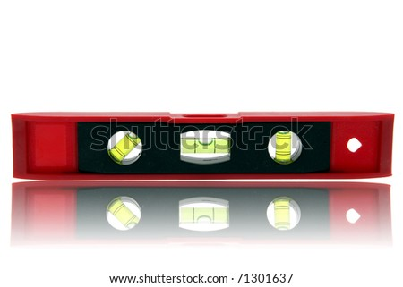 isolated construction water level with its reflection - stock photo
