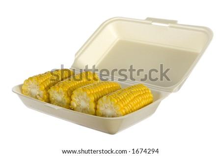 isolated corncobs in styrofoam box - stock photo