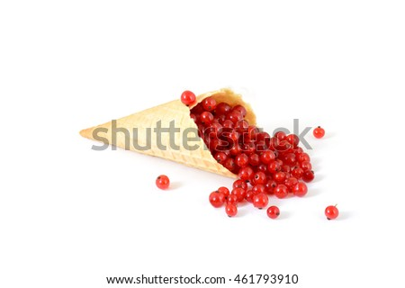 isolated cornet with fresh currant on white background