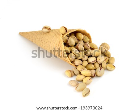 isolated cornet with pistachio on white background - stock photo