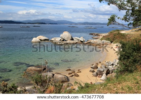 isolated cove with golden sand in Galicia