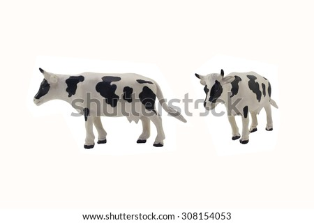 Isolated cow toy photo. Isolated cow toy side and angle view.